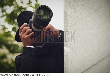 Private Detective With Modern Camera Spying On City Street