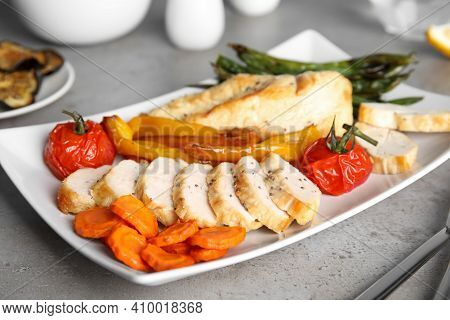 Tasty Cooked Chicken Fillet And Vegetables Served On Grey Table. Healthy Meals From Air Fryer