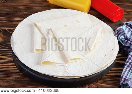 Round Lavash On A Wooden Background. Isolated Pita Bread