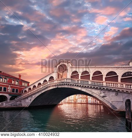 Rialto Bridge On The Grand Canal In Venice, Italy In The Evening On Sunset. Toned Square Image. Roma