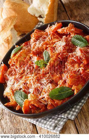 Trippa Alla Romana Roman Style Tripe With Tomato Sauce Closeup In The Plate On The Table. Vertical