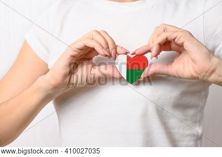 Flag Of Madagascar In The Shape Of A Heart In The Hands Of A Girl. Love Madagascar. The Concept Of P