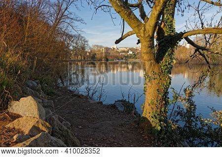 Sun Rises On The Blue Waters Of The Lake In Parc De La Tete D'or