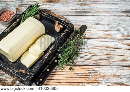 Butter Margarine Block In A Wooden Tray With Herbs. White Wooden Background. Top View. Copy Space