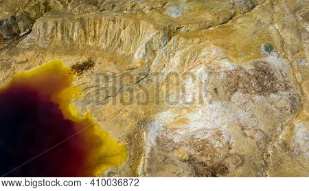 Aerial View Of Abandoned Opencast Copper Mine In Sia, Cyprus. Unusual Colors Derives From Massive Su