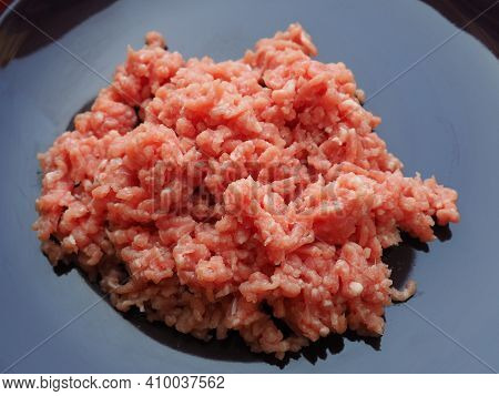 Minced Meat On A Purple Ceramic Large Plate. Delicious Fresh Ground Meat For Making Cutlets, Steaks,