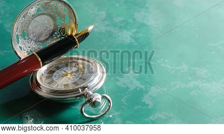 Beautiful Pocket Watch And Fountain Pen Close Up On Marble Background