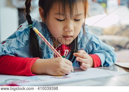 Little Kids Drawing Cartoon With Color Pencil That Is Good Activity For Improve Creative Art And Han