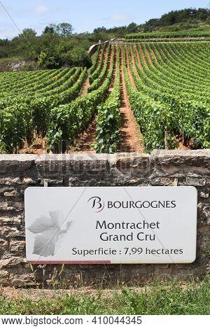 Chassagne-montrachet, France - July 5, 2020: Montrachet Grand Cru, Wine Of Burgundy Road Sign, Franc
