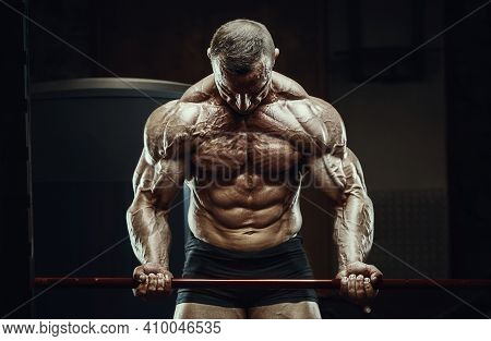 Bodybuilder Pumping Up Biceps Muscles Workout Fitness And Bodybuilding Healthy Concept Background -