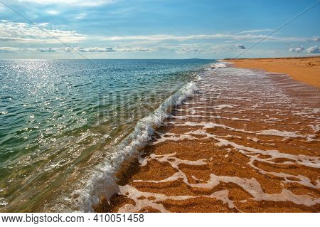 Endless Deserted Yellow Sand Beach, Sunny Day, Calm Turquoise Sea, Blue Sky With White Clouds