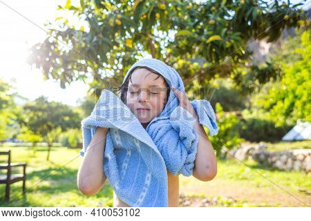 The Child Wipes With A Towel After Swimming In The Pool. Wet Boy Wipes With A Towel.