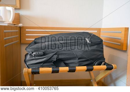 Black luggage in modern hotel room, travel, relaxation, journey, trip and vacation concepts