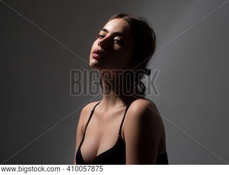 Sensual Women Profile Portrait. Nude Makeup. Silhouette Girl In Bra. Female In Black Underwear