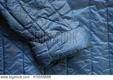 Blue Synthetic Fabric Fabric Texture On An Old Jacket With A Dirty One Sleeve