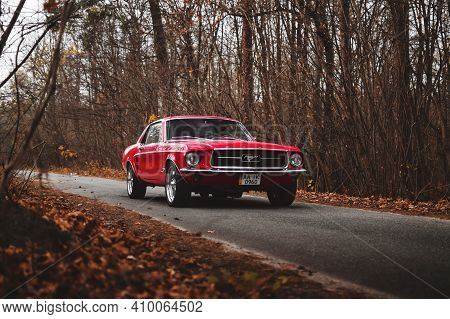 Kyiv, Ukraine - November 2019. Classic Retro American Muscle Car Ford Mustang 1967 In A Red Color In