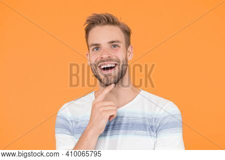 Happy Emotional Guy Close Up. Positive Emotions. Happy Man On Yellow Background. Bearded Man Smiling