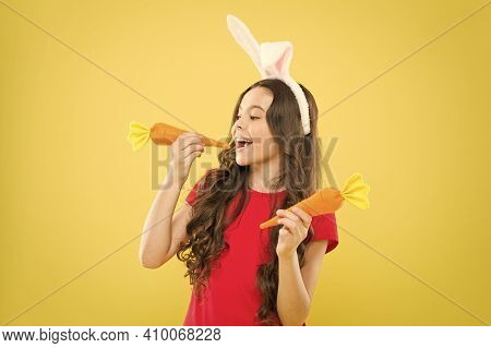 Little Happy Girl Food For Rabbits. Healthy Childhood. Good For Your Teeth. Nibbles A Carrot Like A