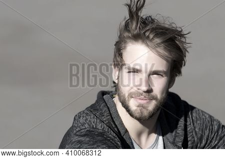 Fashion Guy With Stylish Haircut. Bearded Man With Long Blond Hair Outdoor. Macho With Beard In Spor