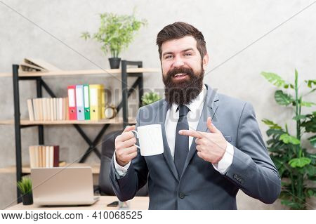 Man Bearded Businessman Hold Coffee Cup Stand Office Background. Successful People Drink Coffee. Dri