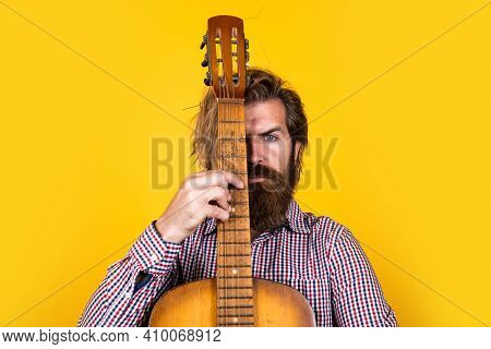 Mature Bearded Man Looking Casual Trendy Playing Guitar, Singer