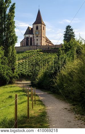 Summer Sunset View Of The Medieval Church Of Saint-jacques-le-major In Hunawihr, Small Village Betwe