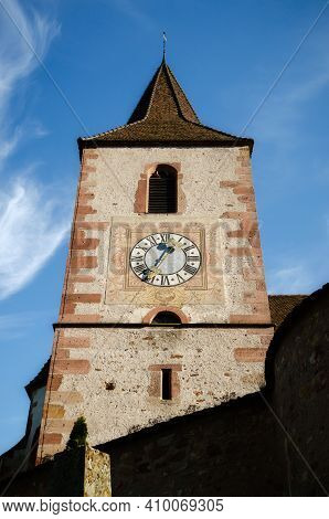 Detail Of Bell Tower And Cloch Of The Medieval Church Of Saint-jacques-le-major In Hunawihr, Village