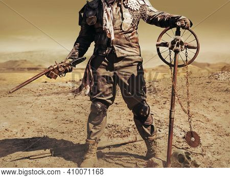 Photo Of A Post Apocalyptic Raider Warrior In Leather Jacket With Metal Armor And Shotgun Weapon Sta