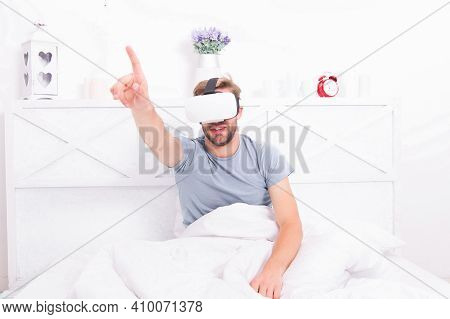 Return To Reality. Man Explore Vr While Relaxing In Bed. Awakening From Virtual Reality. Vr Technolo
