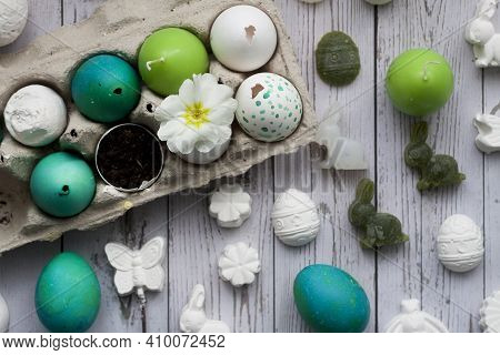 Green And White Easter Eggs In Egg Carton. Candle Egg, Gypsum Egg, Poultry Egg With Ground And White