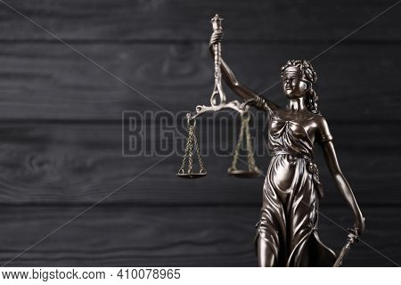 The Statue Of Justice - Lady Justice Or Justitia The Roman Goddess Of Justice. Statue On Black Woode