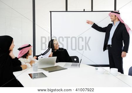 Middle eastern business people with children at office