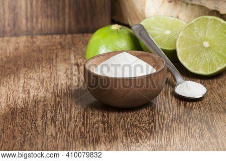 Baking Soda (sodium Bicarbonate) And Lemon; Photo On Wooden Background.