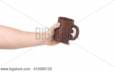 A Man's Hand With A Clay Cup Isolated On A White Background. Copy Space. Clay Cup, Hand Holding A Cl