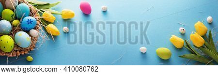 Easter Eggs And Flowers On A Blue Background