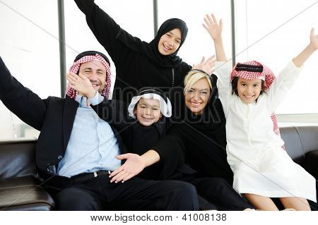 Arabic Muslim family with kids happy at home