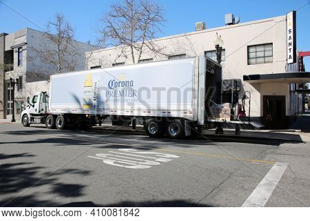 Santa Ana, California - USA - February 25, 2021: Corona Beer truck making deliveries of Beer to a neighborhood Bar. Corona Beer is enjoyed world wide by beer drinking people. Editorial Use Only.