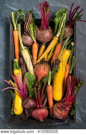 Flat Lay Of Root Vegetable Including Beets, Rainbow Carrots And Yellow Zucchini. Fall Harvest Concep