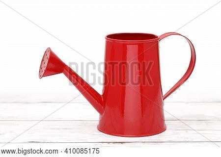 Red Watering Can On White Wooden Table