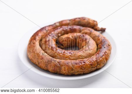 Northern Thai Sausage (sai Aua), Grilled Intestine Stuffed With Minced Pork, Spices And Herbs On Whi