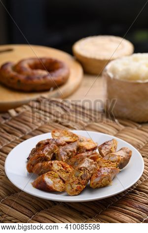 Northern Thai Sausage (sai Aua), Grilled Intestine Stuffed With Minced Pork, Spices And Herbs Eating
