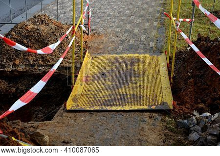 The Path Of The Sidewalk Is Interrupted By Excavation Of A Gutter For Connecting Electricity Using A