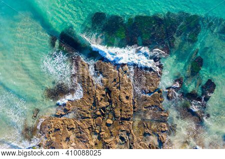 Catherine Hill Bay Aerial View Of Waves Breaking On The Rocky Shore With Clear Water Showing The Roc