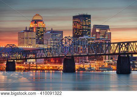 Louisville, Kentucky, USA skyline on the river at dusk.