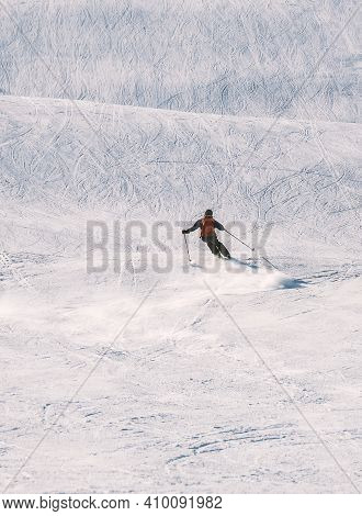 Panorama Of A Downhill Skier On A Slope In Bright Winter Sunlight.