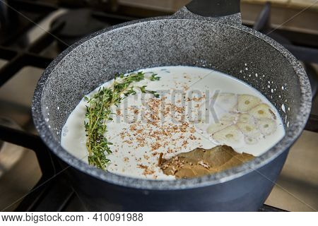 Sauce In A Saucepan Made From Cream, Garlic, Bay Leaf And Nuts