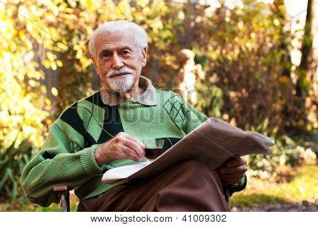 Elderly Man Reading The Paper