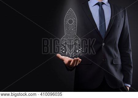 Startup Business Concept, Businessman Holding Icon Transparent Rocket Is Launching And Soar Flying O