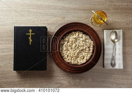 Bible, Oatmeal Porridge And Spoon On Wooden Table, Flat Lay. Lent Season
