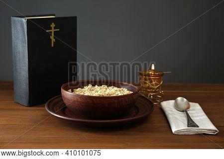 Bible, Oatmeal Porridge And Spoon On Wooden Table. Lent Season
